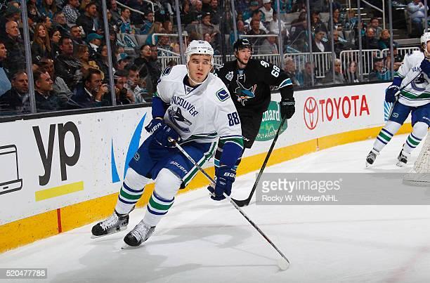 Nikita Tryamkin of the Vancouver Canucks skates against Brent Burns of the San Jose Sharks at SAP Center on March 31 2016 in San Jose California