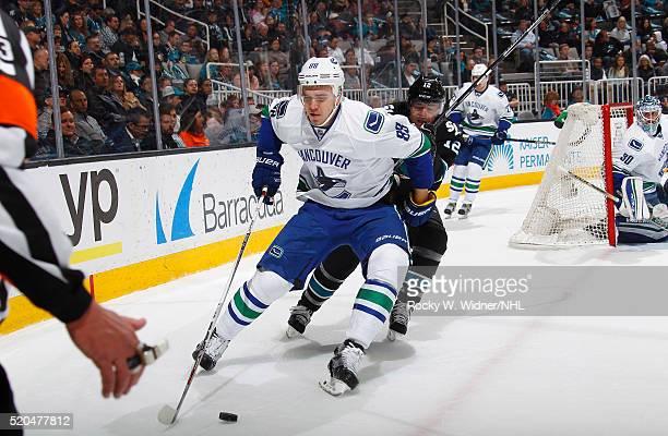 Nikita Tryamkin of the Vancouver Canucks skates against Patrick Marleau of the San Jose Sharks at SAP Center on March 31 2016 in San Jose California