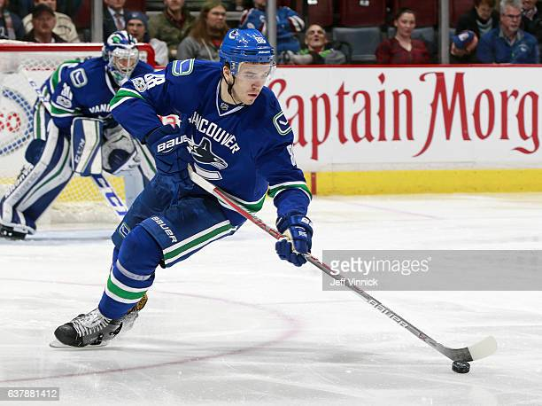 Nikita Tryamkin of the Vancouver Canucks skates up ice with the puck during their NHL game against the Colorado Avalanche at Rogers Arena January 2...