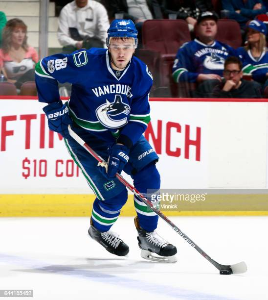 Nikita Tryamkin of the Vancouver Canucks skates up ice with the puck during their NHL game against the Philadelphia Flyers at Rogers Arena February...