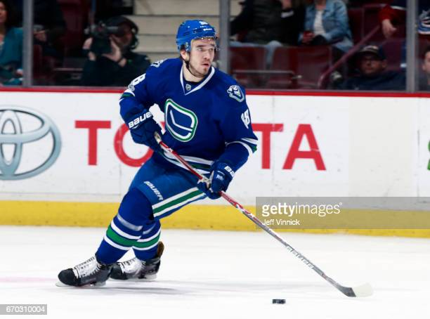 Nikita Tryamkin of the Vancouver Canucks skates up ice with the puck during their NHL game against the San Jose Sharks at Rogers Arena April 2 2017...