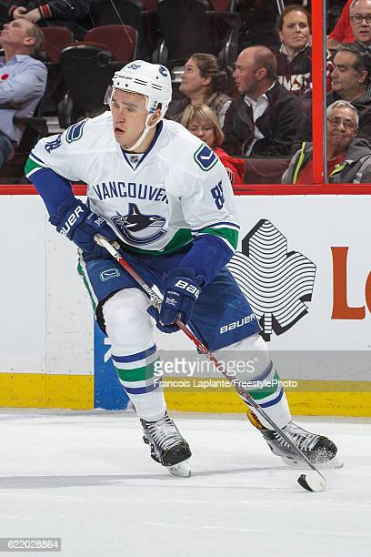 Nikita Tryamkin of the Vancouver Canucks skates with the puck against the Ottawa Senators during an NHL game at Canadian Tire Centre on November 3...
