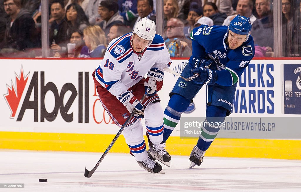 Nikita Tryamkin #88 of the Vancouver Canucks tries to check Jesper Fast #19 of the New York Rangers off the puck during the third period in NHL action on November 15, 2016 at Rogers Arena in Vancouver, British Columbia, Canada.