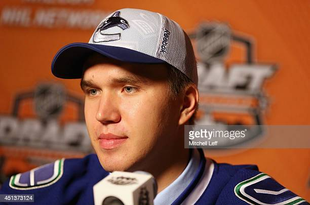 Nikita Tryamkin speaks to the media after being drafted by the Vancouver Canucks on Day Two of the 2014 NHL Draft at the Wells Fargo Center on June...
