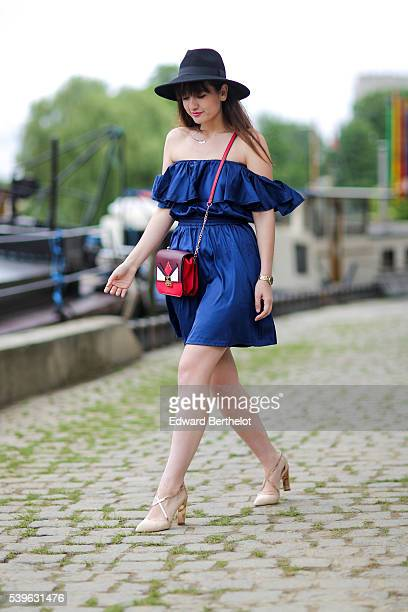 Nikita Wong is wearing a Belmto blue dress a Zara bag Chocolate Schubar shoes and an HM black hat during a street style session on June 12 2016 in...