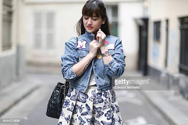 Nikita Wong is wearing a Manoush white top a Chicwish skirt a Manoush blue denim jacket with colored patches Andre nude shoes and a black vintage bag...