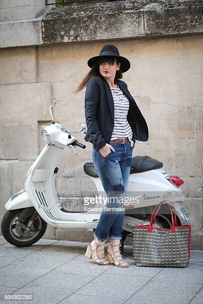 Nikita Wong is wearing Sisley blue jeans an Uncle Jeans striped top with the inscription 'SaintGermain des Pres' a Comptoir des Cotonniers blue...