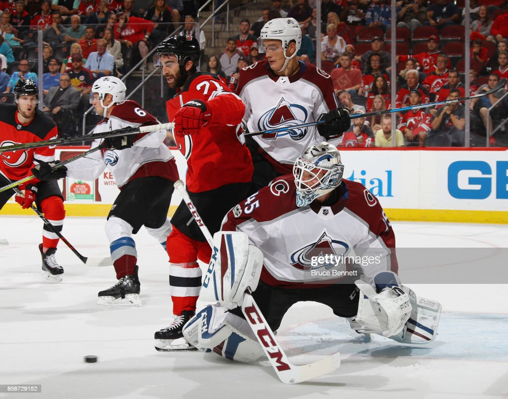 Nikita Zadorov #16 and Jonathan Bernier #45 of the Colorado Avalanche defend against Kyle Palmieri #21 of the New Jersey Devils during the second period at the Prudential Center on October 7, 2017 in Newark, New Jersey.