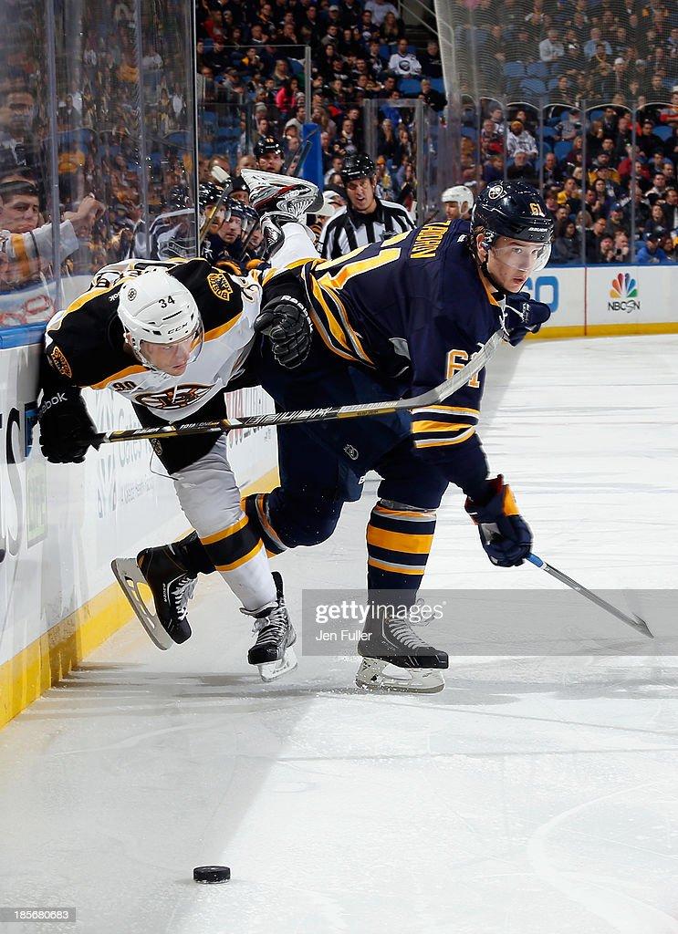 Nikita Zadorov #61 of the Buffalo Sabres checks Carl Soderberg #34 of the Boston Bruins at First Niagara Center on October 23, 2013 in Buffalo, New York.