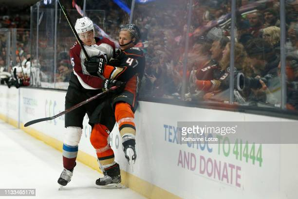 Nikita Zadorov of the Colorado Avalanche checks Hampus Lindholm of the Anaheim Ducks during the third period at Honda Center on March 03, 2019 in...