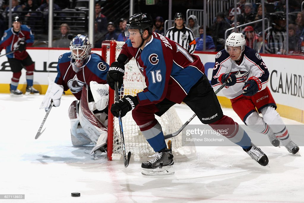 Nikita Zadorov #16 of the Colorado Avalanche clears the puck out of the goal against the Columbus Blue Jackets at the Pepsi Center on December 1, 2016 in Denver, Colorado.