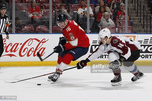 Nikita Zadorov of the Colorado Avalanche defends against Aleksander Barkov of the Florida Panthers as he come in on Goaltender Semyon Varlamov at the...