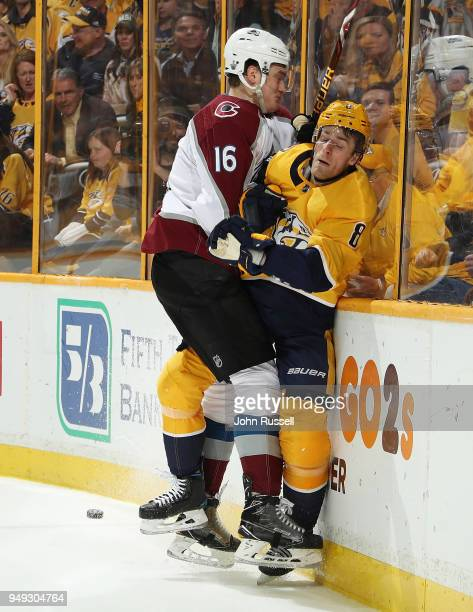 Nikita Zadorov of the Colorado Avalanche delivers a hit on Kyle Turris of the Nashville Predators in Game Five of the Western Conference First Round...