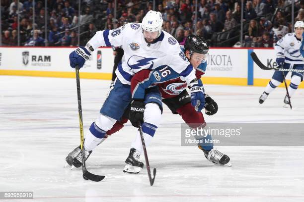 Nikita Zadorov of the Colorado Avalanche fights for position against Nikita Kucherov of the Tampa Bay Lightning at the Pepsi Center on December 16...