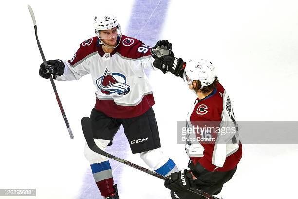Nikita Zadorov of the Colorado Avalanche is congratulated by his teammate Andre Burakovsky after scoring a goal against the Dallas Stars during the...
