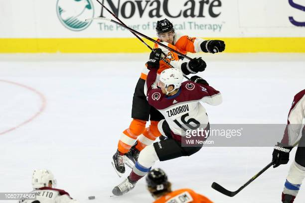 Nikita Zadorov of the Colorado Avalanche is hit by Shayne Gostisbehere of the Philadelphia Flyers during the second period at Wells Fargo Center on...