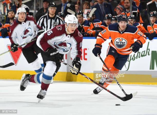 Nikita Zadorov of the Colorado Avalanche while being pursued by Michael Cammalleri of the Edmonton Oilers on February 1 2018 at Rogers Place in...