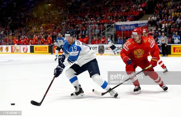 Nikita Zaitsev of Russia challenges Veli Matti Savinainen of Finland during the 2019 IIHF Ice Hockey World Championship Slovakia semi final game...