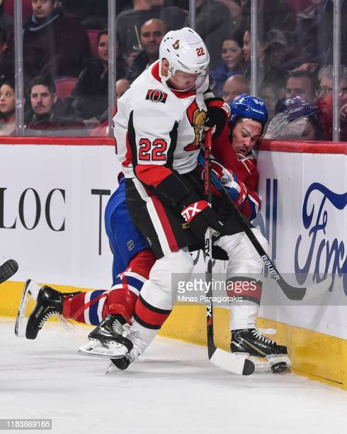 Nikita Zaitsev of the Ottawa Senators pins Charles Hudon of the Montreal Canadiens against the boards during the second period at the Bell Centre on...