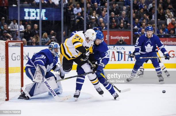 Nikita Zaitsev of the Toronto Maple Leafs battles for the puck against Evgeni Malkin of the Pittsburgh Penguins during the first period at the...