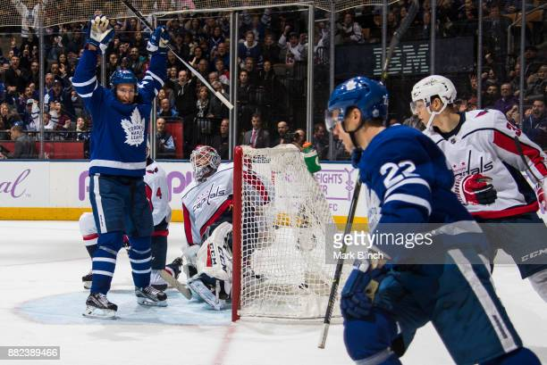 Nikita Zaitsev of the Toronto Maple Leafs celebrates his goal with teammate Dominic Moore against Braden Holtby of the Washington Capitals during the...