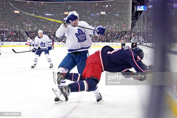 Nikita Zaitsev of the Toronto Maple Leafs checks Artemi Panarin of the Columbus Blue Jackets while chasing after the puck during the second period on...