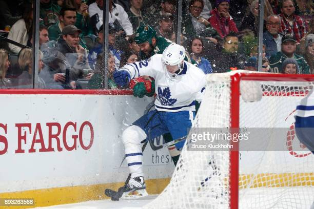 Nikita Zaitsev of the Toronto Maple Leafs collides with Daniel Winnik of the Minnesota Wild during the game at the Xcel Energy Center on December 14...