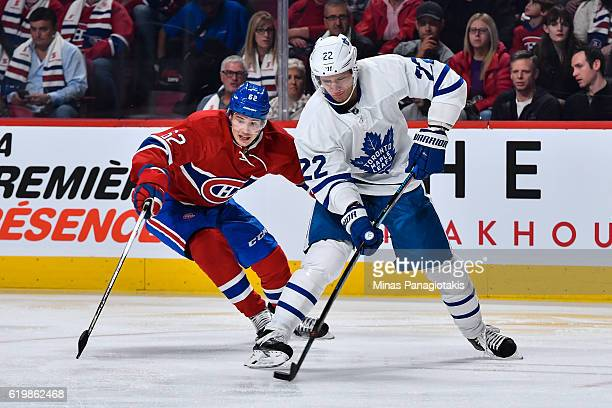 Nikita Zaitsev of the Toronto Maple Leafs skates the puck against Artturi Lehkonen of the Montreal Canadiens during the NHL game at the Bell Centre...