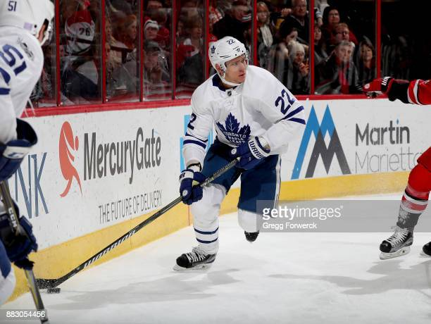 Nikita Zaitsev of the Toronto Maple Leafs skates with the puck behind the net during an NHL game against the Carolina Hurricanes on November 24 2017...