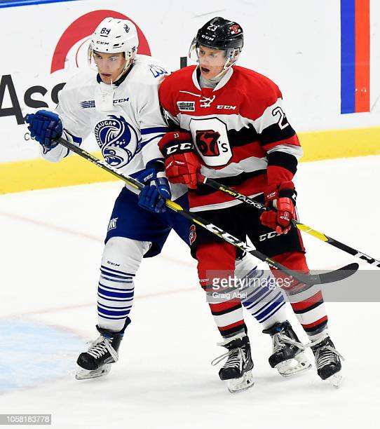 Nikita Zuyev of the Mississauga Steelheads battles with Marco Rossi of the Ottawa 67's during OHL game action on October 21, 2018 at Paramount Fine...