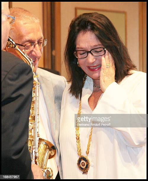 Nikitas Kalamanis, Mayor of Athens, and Nana Mouskouri during a ceremony awarding Nana Mouskouri with the Gold Medal of the city of Athens, within...