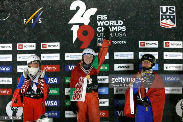 Nikitina Liubov of Russia second place Aliaksandra Ramanouskaya of Belarus first place and Mengtao Xu of China in third place celebrate on the podium...