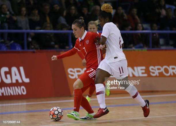Nikitina of Russia with Lidia Moreira of Portugal in action during the FUTSAL International match between Portugal and Russia at Pavilhao Municipal...