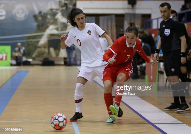 Nikitina of Russia with Sara Ferreira of Portugal in action during the FUTSAL International match between Portugal and Russia at Pavilhao Municipal...