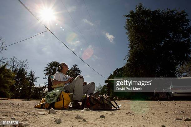 Nikki Bacharach of Los Angeles sits in the parking lot of the Parkfield Inn waiting for aftershocks on September 30 2004 Parkfield California The...
