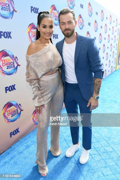 Nikki Bella and Artem Chigvintsev attend FOX's Teen Choice Awards 2019 on August 11, 2019 in Hermosa Beach, California.