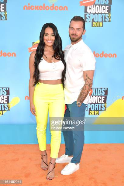 Nikki Bella and Artem Chigvintsev attend Nickelodeon Kids' Choice Sports 2019 at Barker Hangar on July 11 2019 in Santa Monica California
