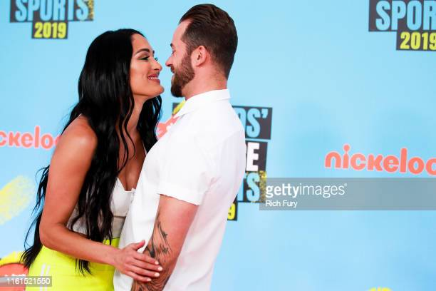 Nikki Bella and Artem Chigvintsev attend the Nickelodeon Kids' Choice Sports at Barker Hangar on July 11 2019 in Santa Monica California