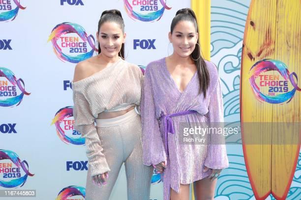 Nikki Bella and Brie Bella attend FOX's Teen Choice Awards 2019 on August 11 2019 in Hermosa Beach California
