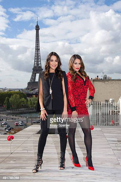 Nikki Bella and Brie Bella pose during the 'Total Divas' Paris Photocall at La Maison Blanche on October 8 2015 in Paris France