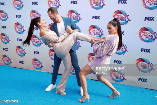 Nikki Bella, Artem Chigvintsev, and Brie Bella attend FOX's Teen Choice Awards 2019 on August 11, 2019 in Hermosa Beach, California.