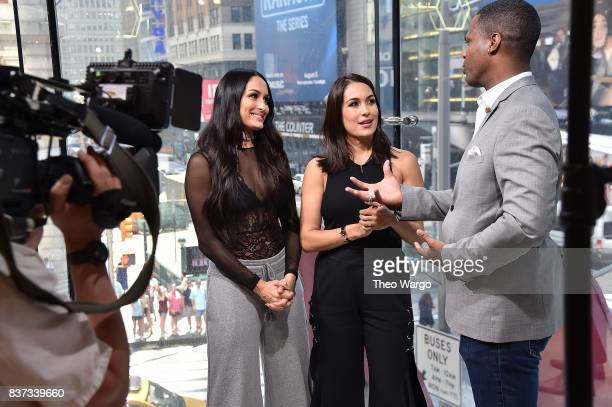 Nikki Bella Brie Bella and AJ Calloway during a taping of The Bella Twins Visit Extra at HM Times Square on August 22 2017 in New York City