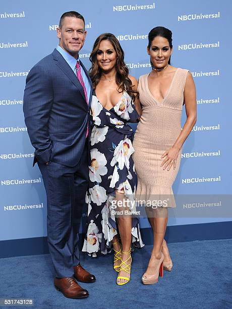 Nikki Bella John Cena and Brie Bella attend the NBCUniversal 2016 Upfront Presentation on May 16 2016 in New York City