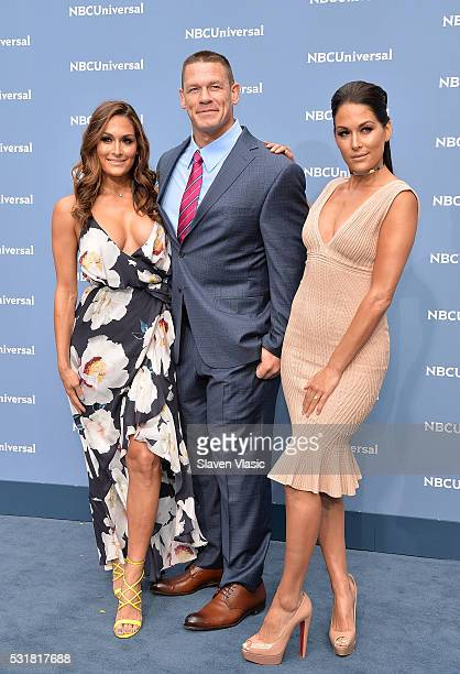 Nikki Bella John Cena and Brie Bella attend the NBCUniversal 2016 Upfront Presentation on May 16 2016 in New York New York