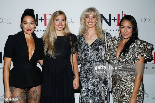 Nikki Bella Vanessa Fischetti Ashley Cole and Brie Bella attend the Beauty moguls Nikki and Brie Bella launch of their new product line during...