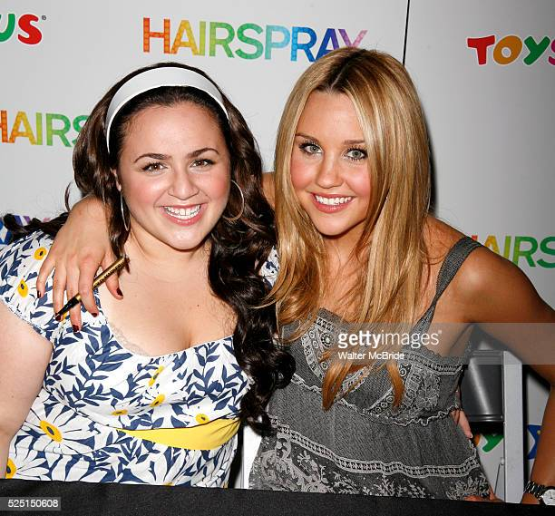 Nikki Blonsky and Amanda Bynes of the HAIRSPRAY movie helps raise the curtain on the new Doll Line at Toys R Us in Times Square New York City USA...