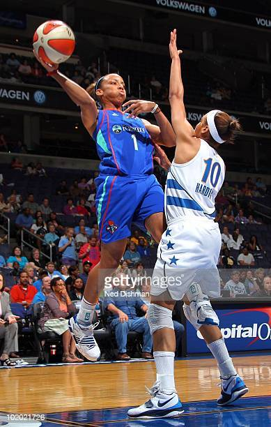 Nikki Blue of the New York Liberty passes against Lindsey Harding of the Washington Mystics at the Verizon Center on June 12 2010 in Washington DC...