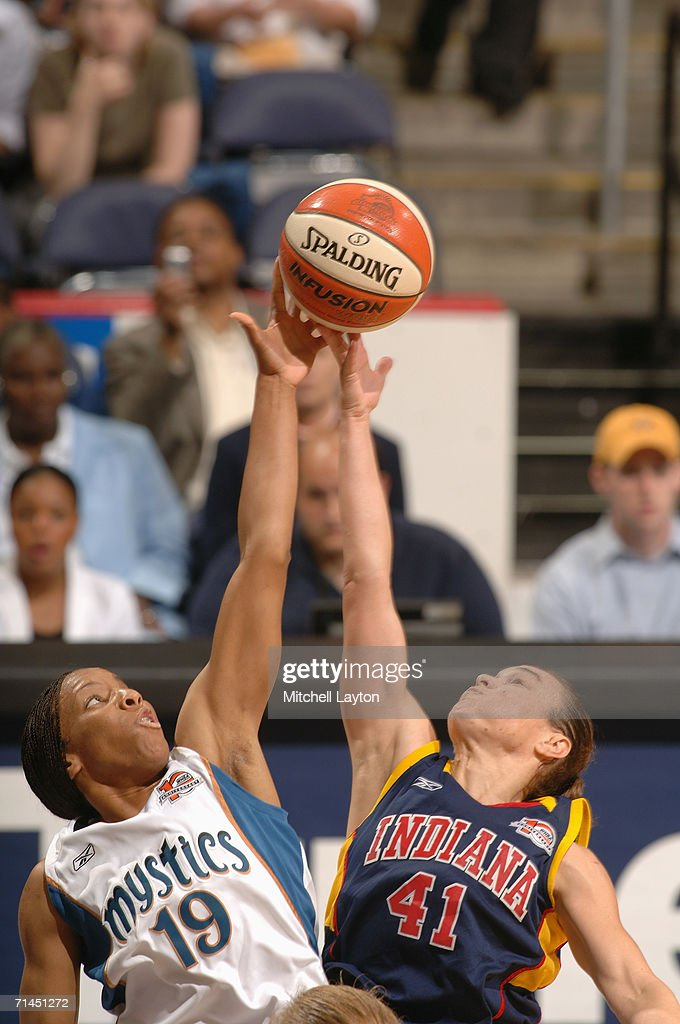 Nikki Blue #19 of the Washington Mystics and Tully Bevilaqua #41 of the Indiana Fever battle for a jump ball during a game at MCI Center on June 27, 2006 in Washington, D.C. The Fever won 74-67.
