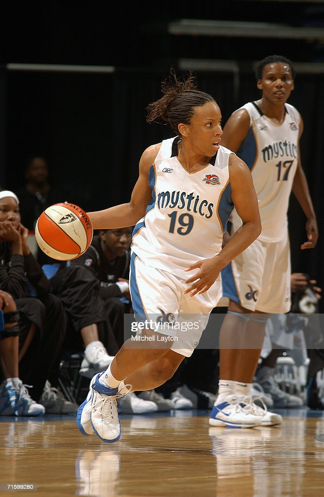 Nikki Blue #19 of the Washington Mystics dribbles the ball against the Chicago Sky on July 27, 2006 at MCI Center in Washington, D.C. The Mystics won 92-74.