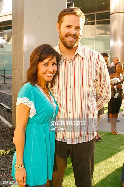 Nikki Boyer and David Denman arrive at the Los Angeles premiere of Who's Your Caddy at the Arclight Theater on July 23 2007 in Hollywood California